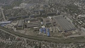 Drone. View from above. In the middle of the city is an old factory. stock footage