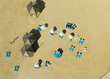 Drone view of beach hut. Drone view of 3 beach hut with blue with blue beach beds Royalty Free Stock Images