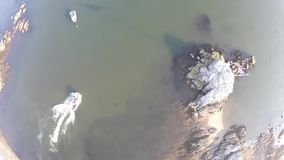 Drone View Of A Boat Passing By. Drone view of a beach in a small New England town with a boat passing by stock video footage