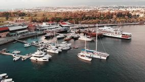 Drone view of beautiful luxury yachts and boats at city harbor. Aerial shot of marina with luxurious and pleasure boats stock video
