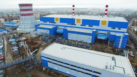 Blue workshops at thermal power plant generating electrical energy. Drone view blue workshops at thermal power plant generating electrical energy by converting stock video