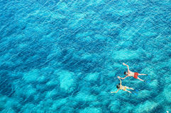 Drone view of couple snorkeling in sea water Royalty Free Stock Images