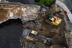 Drone view on excavators demolishing a road bridge royalty free stock photos