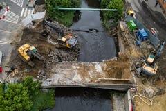 Drone view on excavators demolishing a road bridge stock photography