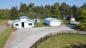 Drone view of the farm yard with barn, garage. stock photos