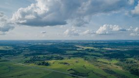 Drone view of fields, forests and sky royalty free stock photography
