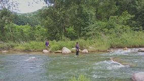 Drone View Fisher Throws Net into River Takes out in Tropics stock video footage