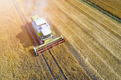 Drone view of harvester combine working on field. Royalty Free Stock Images