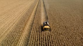 Drone view of harvester mowing corn field stock image