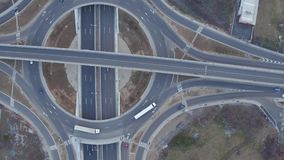 Drone view of high speed freeway and interstate bridges crossing the road circle, aerial view stock video