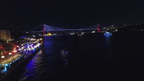 Drone view of Istanbul Bosphorus at night. A drone fly video from Besiktas to Bosphorus bridge at a romantic night. Boats are running on sea and bridge lights stock video