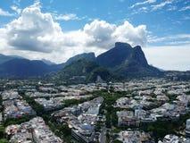 Drone view of Jardim Oceanico region in Barra da Tijuca,Gavea Stone hill, Rio de Janeiro. Drone photo of Barra da Tijuca boardwalk and Lucio Costa street, Rio de royalty free stock image