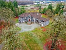 Drone view of a luxurious stone wedding venue. Drone aerial view of a luxurious stone wedding venue in Seattle, WA royalty free stock images