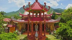 Drone View Old Pagoda Entrance against Hills Blue Sky stock video footage