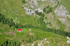 Drone view of mountain meadow and a lodge. Drone shot of mountain meadow and a lodge Royalty Free Stock Images