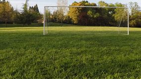 Drone View Moving Towards And Above Empty Soccer Net stock footage