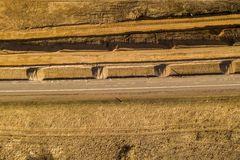Drone view of road repair work in rural landscape.  stock image