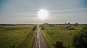 Drone view of rural road during sunset stock photo