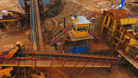 Drone view of sand moving on automatic conveyor belt. Industrial mining conveyor stock footage