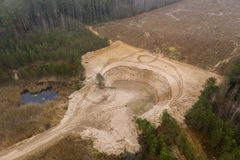 Drone view sand pit in the middle of the forest rural landscape royalty free stock image