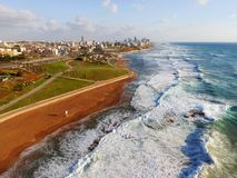 Drone view of shore line. Drone view of urban shore line with promenade and green park Stock Photography