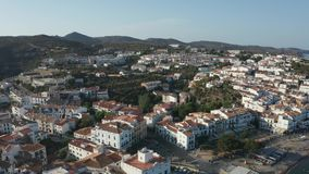 Aerial view of coastal resort town Cadaques. Drone view of Spanish historical town Cadaques with tiled terracotta roofs, white houses, narrow streets on stock video