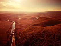 Drone view of stunning colorful autumn fall forest at sunset Royalty Free Stock Photo
