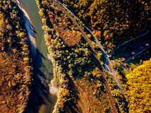 Drone view of stunning colorful autumn fall forest at sunset Stock Images