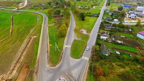 Drone view of suburban road construction. Cargo trucks driving on country road stock video footage