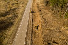 Drone view of trucks, bulldozer and road repair work in rural landscape. Drone photography stock images