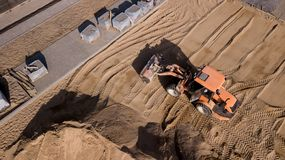 Drone view of trucks, excavators and road repair work in rural landscape. Drone photography stock photos