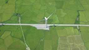 Drone view wind turbine on alternative energy station on green field. Alternative natural source and ecology. Conservation. Wind power generation. Green stock footage