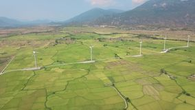 Drone view windmill turbine in field on mountain landscape. Wind energy station generating clean renewable energy. Wind. Energy plant power turbine. Alternative stock footage