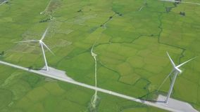 Drone view windmill turbine on green field background. Wind power turbine generation on energy station aerial view. Alternative energy sources, ecology and stock video footage