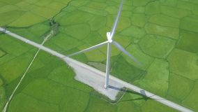 Drone view windmill turbine on green field. Wind power turbine generation on energy station aerial view. Alternative. Energy sources, ecology, environment stock footage