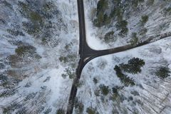 Drone view of winter forest road royalty free stock photos