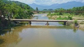 Drone View Women Washes Clothes in River against Nature. GIANG-LY/VIETNAM - APRIL 28 2017: Drone removes from Asian women washing clothes in wide transparent stock footage