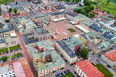 Drone view on Zamosc old town and city main square with town hall royalty free stock photos