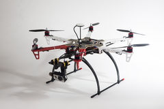 Drone with white and red arms. A hexacopter with attached camera on a white background Stock Photography