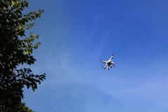 Drones camera with branches and the blue sky. Drones camera with branches and treetops with the blue sky background stock photography
