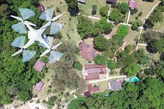 Drones camera flying in the sky with mountains village views. In Thailand royalty free stock images