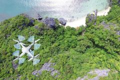 Drones camera flying in the sky with ocean views. Drones camera flying in the sky with ocean lagoon views by the beach stock photo