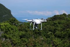Drones camera in the sky with ocean views background. Drones camera flying in the sky with ocean and mountain views background royalty free stock photos