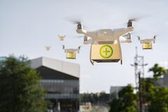 Free Drones Carry Medical Help, Medicines In Boxes, Covid19 Aid Stock Image - 177279751