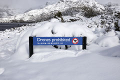 Drones Prohibited sign in the snow Stock Photos