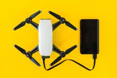 Drones with small white. Small Drones are charging their batteries with Power Bank stock photos