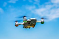 Drones with small white. Small drones are flying in the sky stock image