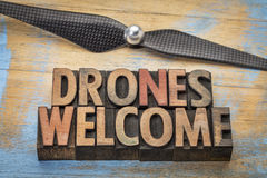 Drones welcome word abstract. In vintage letterpress wood type with a drone propeller royalty free stock photography