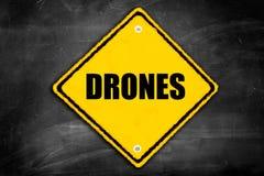 Drones written on caution sign Stock Photos