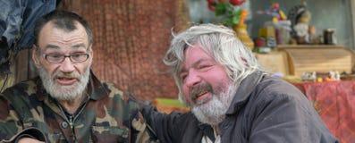 Dronken daklozen stock afbeeldingen